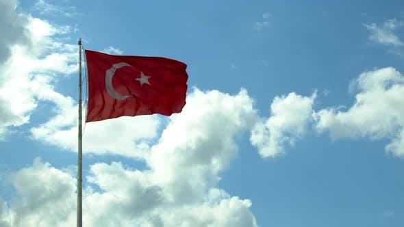 Turkey Flag Waving Against Cloudy Sky Background