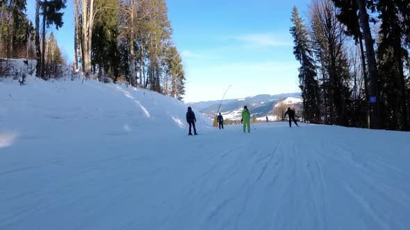 Thumbnail for POV Downhill Skiing on Ski Slope at a Ski Resort. People Skiing on a Slope