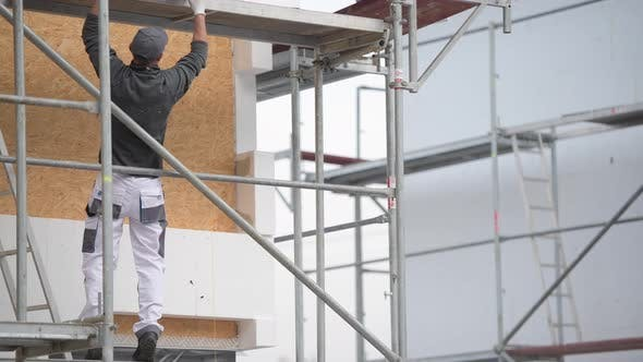 Building Insulation by Caucasian Construction Worker