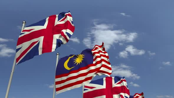 Flags of Malaysia and the United Kingdom Against Blue Sky