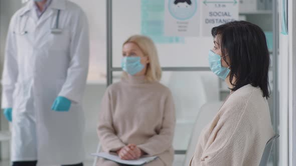 Thumbnail for Women in Masks Waiting for Appointment in Medial Office