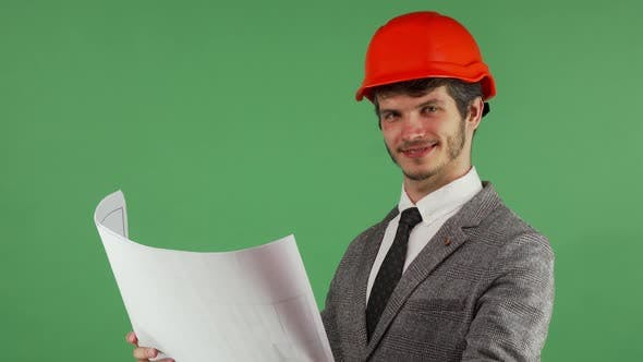 Thumbnail for Happy Architect Examining His Blueprints Smiling Joyfully