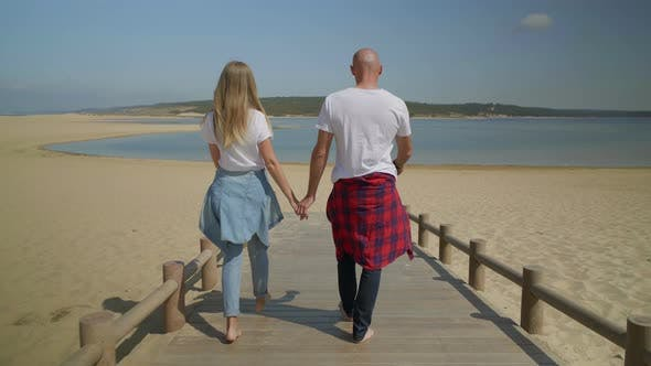 Thumbnail for Barefoot Couple Walking Together on Beach