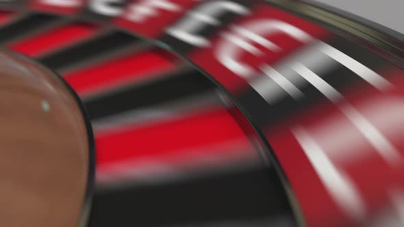 Thumbnail for Ball in Dollar Sign Pocket on Casino Roulette Wheel