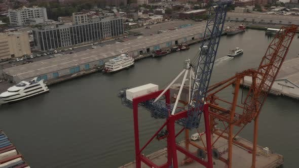 Thumbnail for High Angled View of Industrial Cranes in Docks in New York City on Cloudy Day