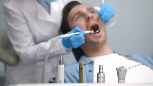 Dental Instruments and Patient at Dental Clinic