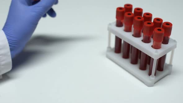 Thumbnail for Positive Beta hCG Test, Doctor Showing Blood Sample in Tube, Health Checkup