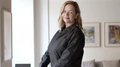 Medium Shot of Confident Businesswoman Smiling at Camera