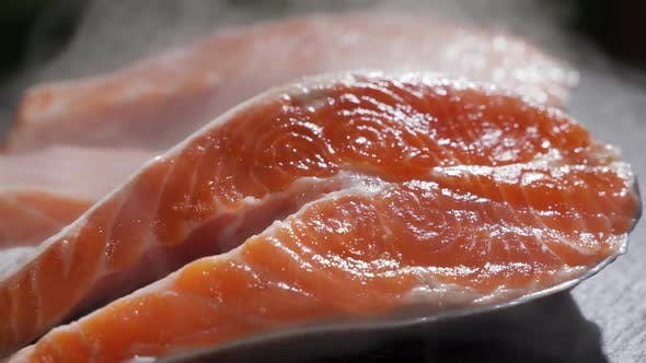 Cover Image for Motion Video of Salmon Sushi on Black Dish in the Restaurant (Selective Focus)