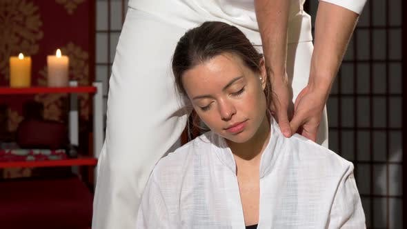 Cover Image for Lovely Woman Smiling with Her Eyes Closed Enjoying Thai Massage at Spa