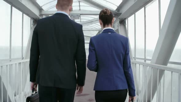 Thumbnail for Business Partners Walking Away