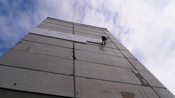 Industrial Climber Insulation of Facade Old High-Rise Building Using Styrofoam