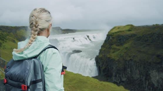 Waterfall Gullfoss and Tourist Woman