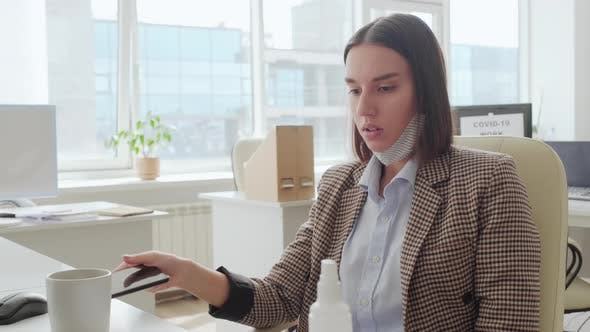 Frustrated Businesswoman Stressing in Office during Covid-19