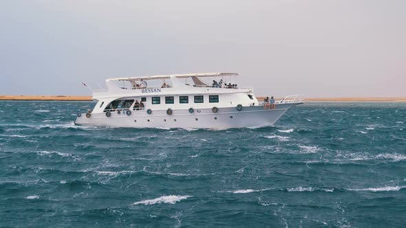 Thumbnail for Pleasure Boat with Tourists Is Sailing in the Storm Sea. Egypt, Sharm El Sheikh
