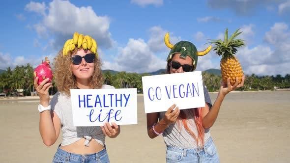 Thumbnail for Healthy Vegan Lifestyle: Funny Cheerful Women Friends With Fruits on Beach
