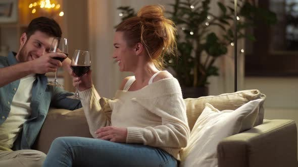 Thumbnail for Happy Couple Drinking Red Wine at Home in Evening