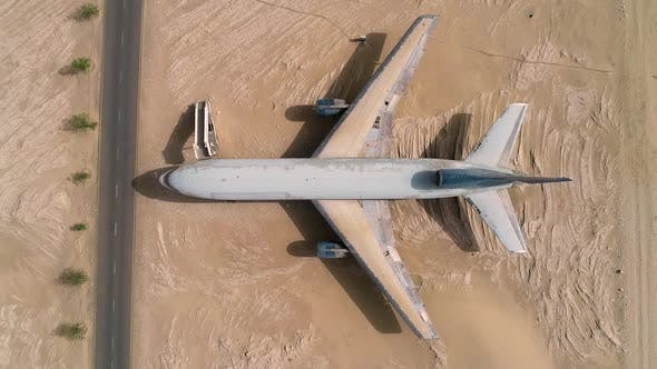 Aerial view above of museum airplane on desert landscape, Abu Dhabi, U.A.E