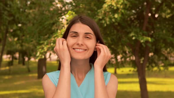 Thumbnail for Portrait Cheerful Young Woman Use Headphones Outdoors