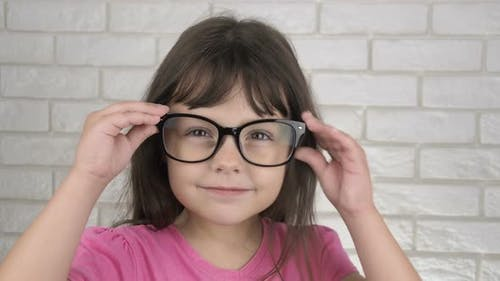 The Child Takes Off Glasses for Sight
