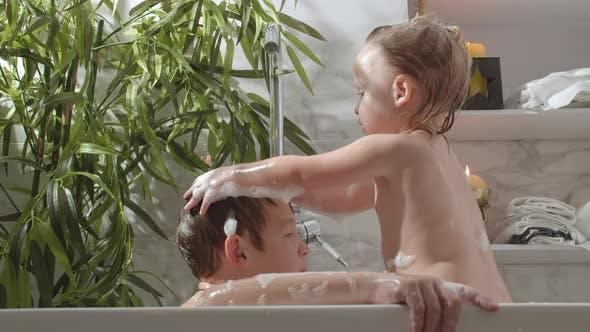 Children Bathing in Foamy Water