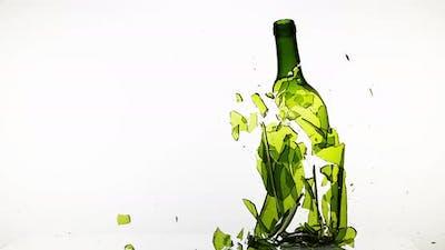 900133 Bottle of White Wine Breaking against White Background, Slow motion 4K