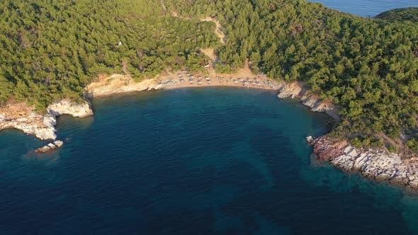Aerial View of Beach Umbrellas and Sunbeds, Mediterranean Forest. Thassos island, Greece