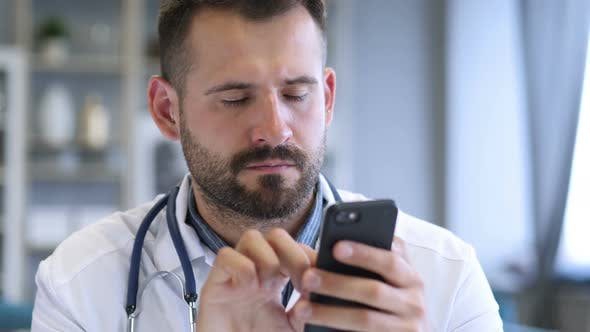 Doctor Browsing on Smartphone in Clinic