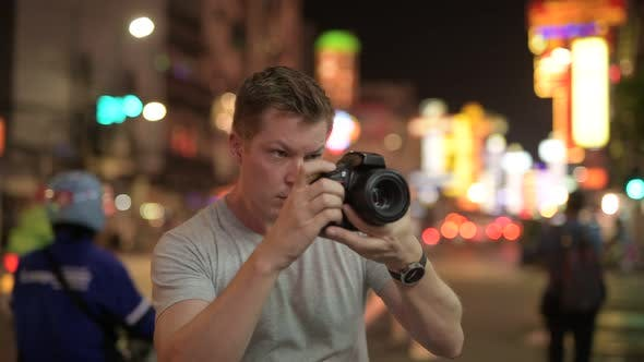 Thumbnail for Young Tourist Man Photographing with Camera in the Streets of Chinatown at Night