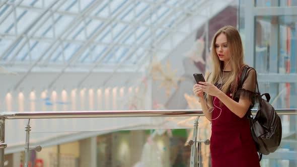 Thumbnail for Smiling Female Blogger Listening Favorite Songs in Headphones While Posing for Selfie on Smartphone
