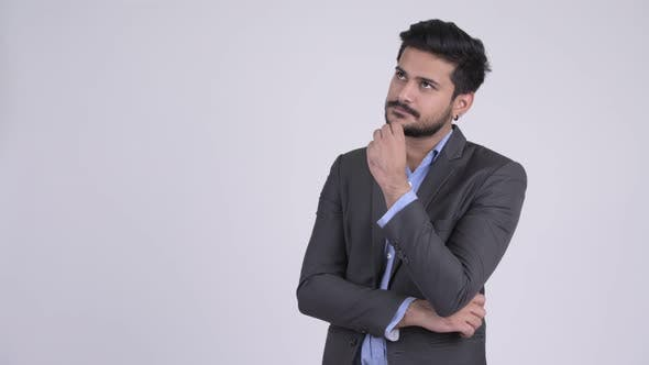 Thumbnail for Young Happy Bearded Indian Businessman Thinking