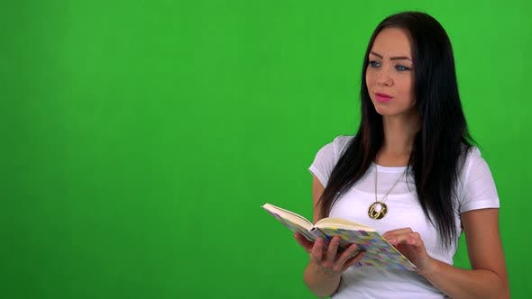 Thumbnail for Young Pretty Woman Reads Book - Green Screen - Studio