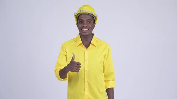 Thumbnail for Young Happy African Businessman As Engineer Giving Thumbs Up