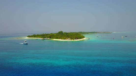Thumbnail for Wide angle aerial abstract shot of a white paradise beach and blue sea background in best quality 4K