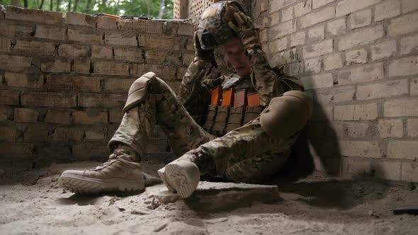 Thumbnail for Tired After Battle Army Soldier Sitting on Ground