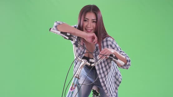 Thumbnail for Asian woman on her bicycle on green screen
