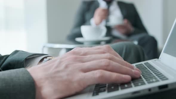 Using Laptop During Coffee Break