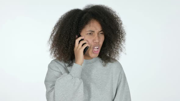 Thumbnail for African Woman Angry on Smartphone, White Background