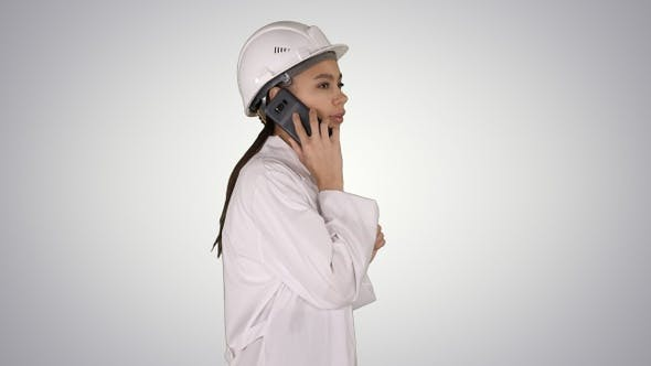 Thumbnail for Female science engineer making a call while walking on