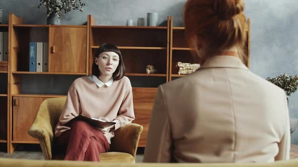 Thumbnail for Young Female Counselor Speaking with Woman during Consultation