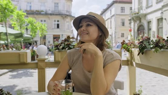 Thumbnail for Mature Smiling Woman Relaxing and Drinking Drink with Mint Lime