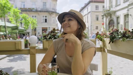 Mature Smiling Woman Relaxing and Drinking Drink with Mint Lime