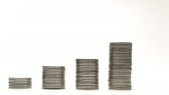 Thumbnail for Silver Coins on Stacks Are Decrease and Increase on White Background Stop Motion Animation