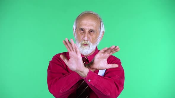 Thumbnail for Portrait of Happy Old Aged Man 70s Strictly Gesturing with Hands Crossed Making X Shape Meaning
