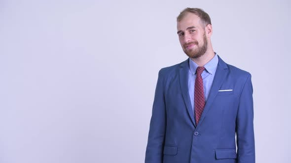Thumbnail for Happy Bearded Businessman Touching Something