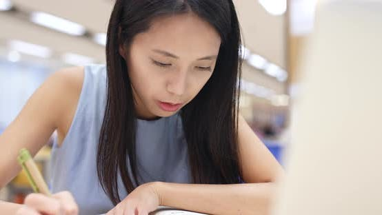 Thumbnail for Woman Working on Homework in Library