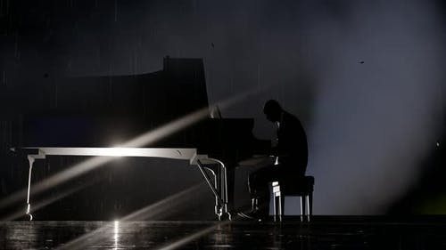 The Man Playing the Piano in the Fog