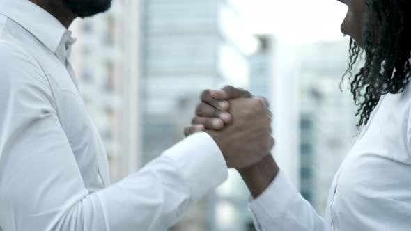 Thumbnail for Slow Motion Shot of People Shaking Hands on Street
