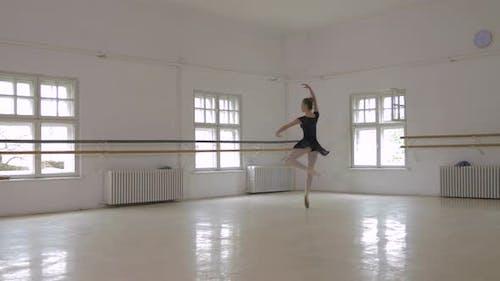 Ballerina doing pirouettes