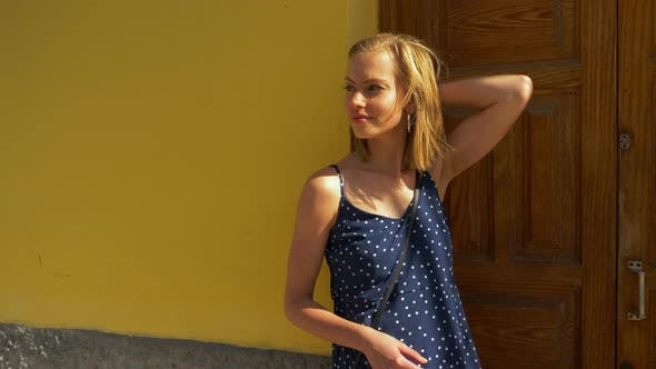 Thumbnail for Half Body Shot of a Tantalizing Woman in Blue Polka Dots Top